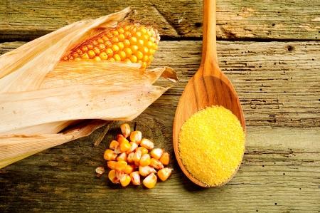 maize flour: maize  flour over spoon   Stock Photo
