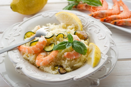 bulgur: couscous with shrimp and zucchinis Stock Photo