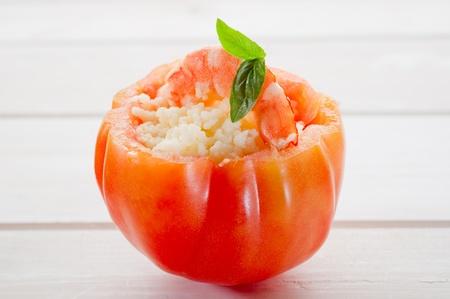 open tomato with couscous shrimp  photo