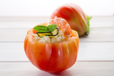 open tomato with couscous shrimp and zucchinis photo