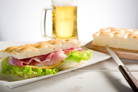 sandwich with white pizza  turkey ham and beer photo