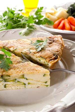 omelette with zucchinis and parsley photo