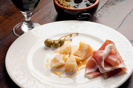 appetizer parma cheese  honey and parma ham photo