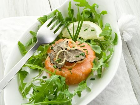 truffle: salmon tartare with truffle and arugula salad Stock Photo