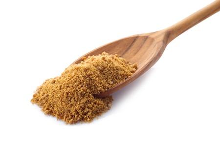 brown sugar over wood spoon photo
