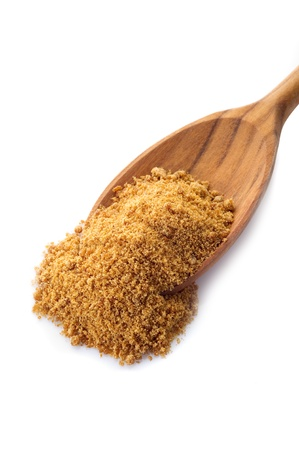 granulated: brown sugar over wood spoon