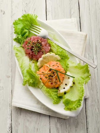seafood salad: salmon and tuna tartare with green salad Stock Photo