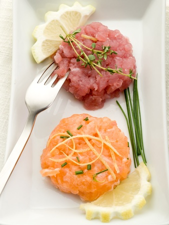tartar: salmon and tuna tartare with lemon and chive Stock Photo