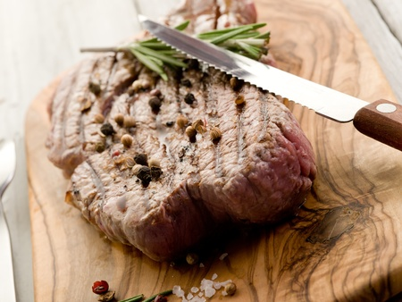 cooked meat: grilled tenderloin with pepper and rosemary