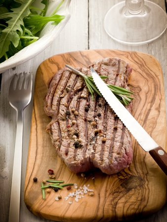 grilled tenderloin with arugula salad photo