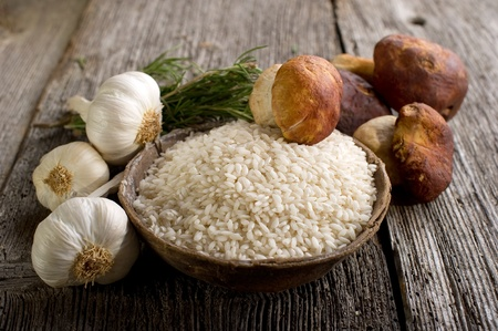 raw rice  and cep mushroom photo