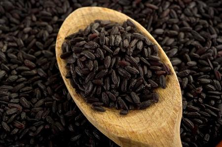 black rice on wood spoon photo