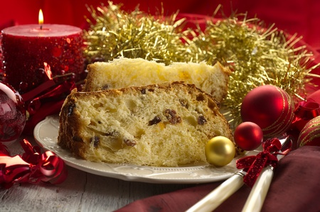 panettone traditional italian christmas dessert on red luxury table photo