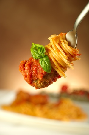 pasta fork: spaghetti with meatballs and tomatoes sauce