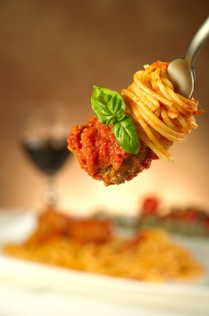 american cuisine: spaghetti with meatballs and tomatoes sauce