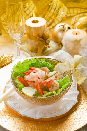 shrimp cocktail on golden table photo