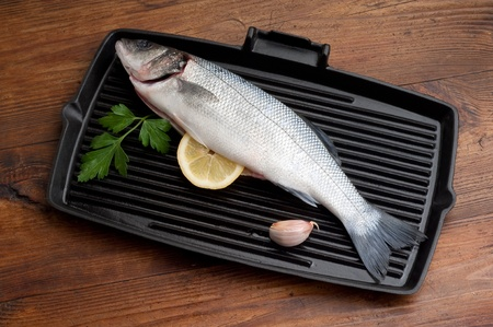 seabass with ingredients ready to cooking photo