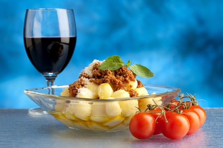 wine and dine: gnocchi with ragout sauce Stock Photo