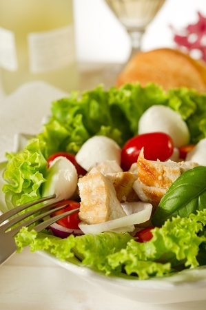 mixed salad with grilled chicken and cherry mozzarella