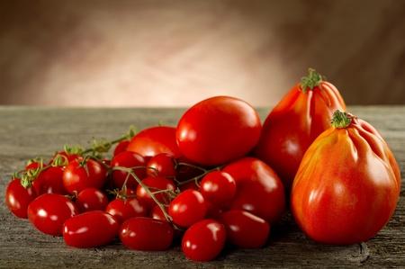 tomatoes on wood background photo