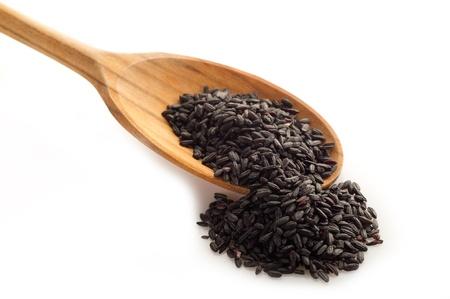 wild rice: raw black rice on white