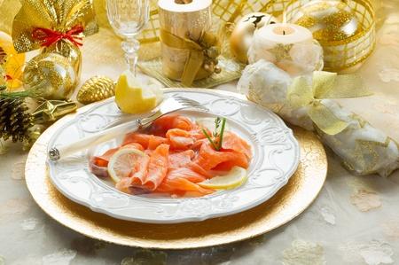 salmon on dish on christmas table photo