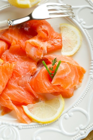 Glasses of champagne and candles: salmon on dish on christmas table