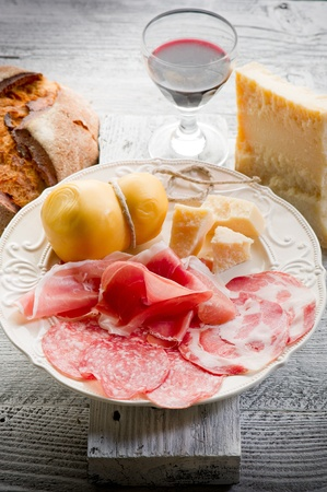 variety of italian salami and cheese  photo