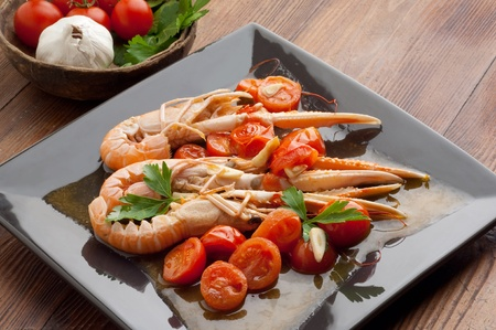 norway lobster with sliced cherry tomatoes photo