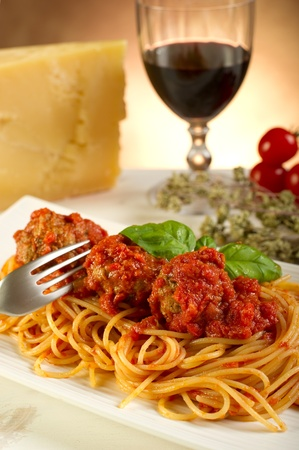 eating pasta: spaghetti with meatballs and tomatoes sauce