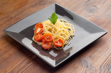 spaghetti with  sliced  tomatoes photo