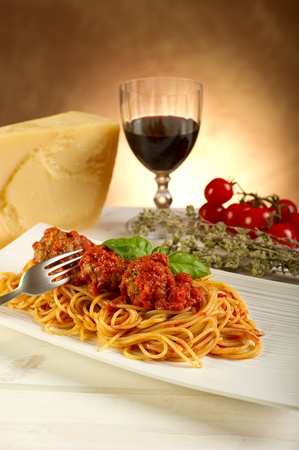 spaghetti with meatballs and tomatoes sauce photo