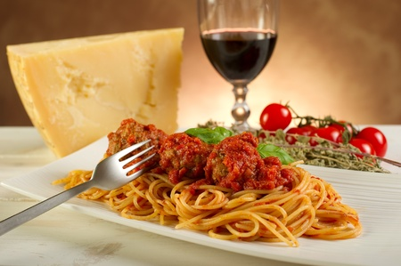 wine and food: spaghetti with meatballs and tomatoes sauce