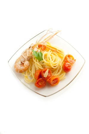 spaghetti with norway lobster and sliced  tomatoes photo
