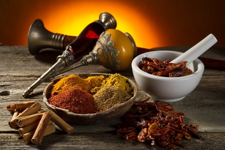 arabian food: variety of spice on wood background