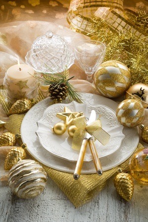 gold xmas table with decorations photo