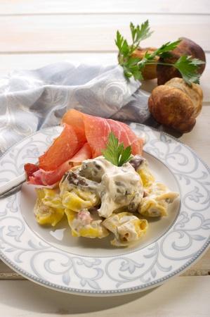 emilia romagna: tortellini wit parma ham and cream sauce Stock Photo