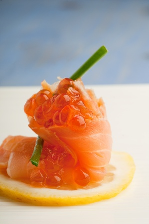 pink salmon: appetizer with soked salmnon and eggs