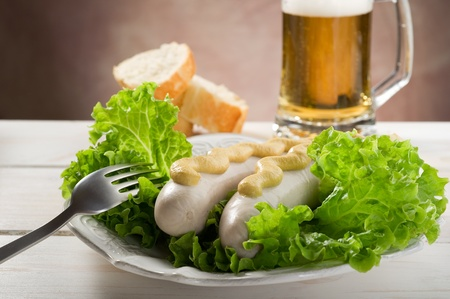 veal sausage: wurstel with green salad Stock Photo