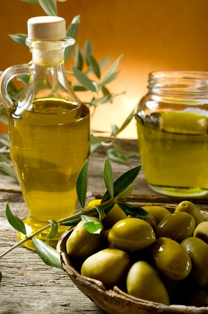 olive oil on wood background Stock Photo - 10408754