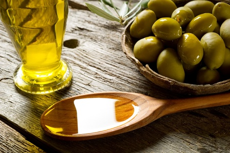 extra: olive oil on wood background