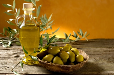 plant oil: olive oil on wood background