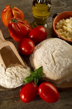 dough and ingredients for homemade pizza Stock Photo - 10425916