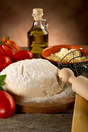 dough and ingredients for homemade pizza photo