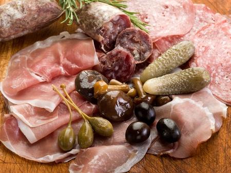 italian appetizer with salami, grana,speck,mushroom,cucumber photo