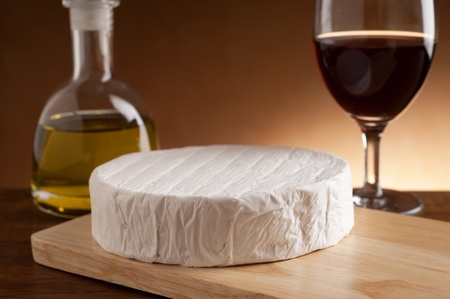 camembert over cutting board Stock Photo - 10426005