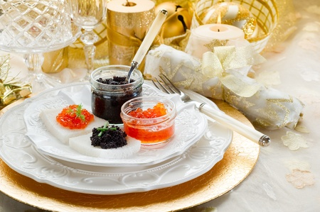 Glasses of champagne and candles: caviar canape