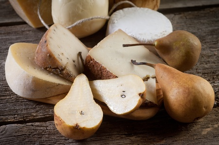 variety of italian cheese and pears photo