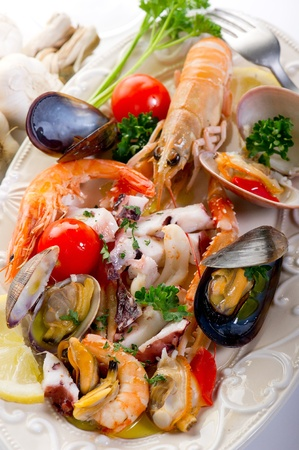 seafood dinner: sea salad on dish Stock Photo