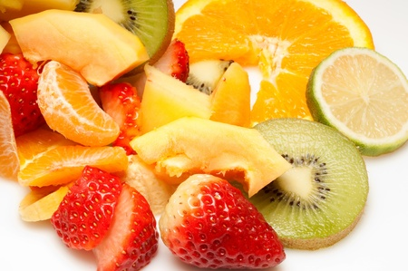 tropical fruits salad on pineapple photo